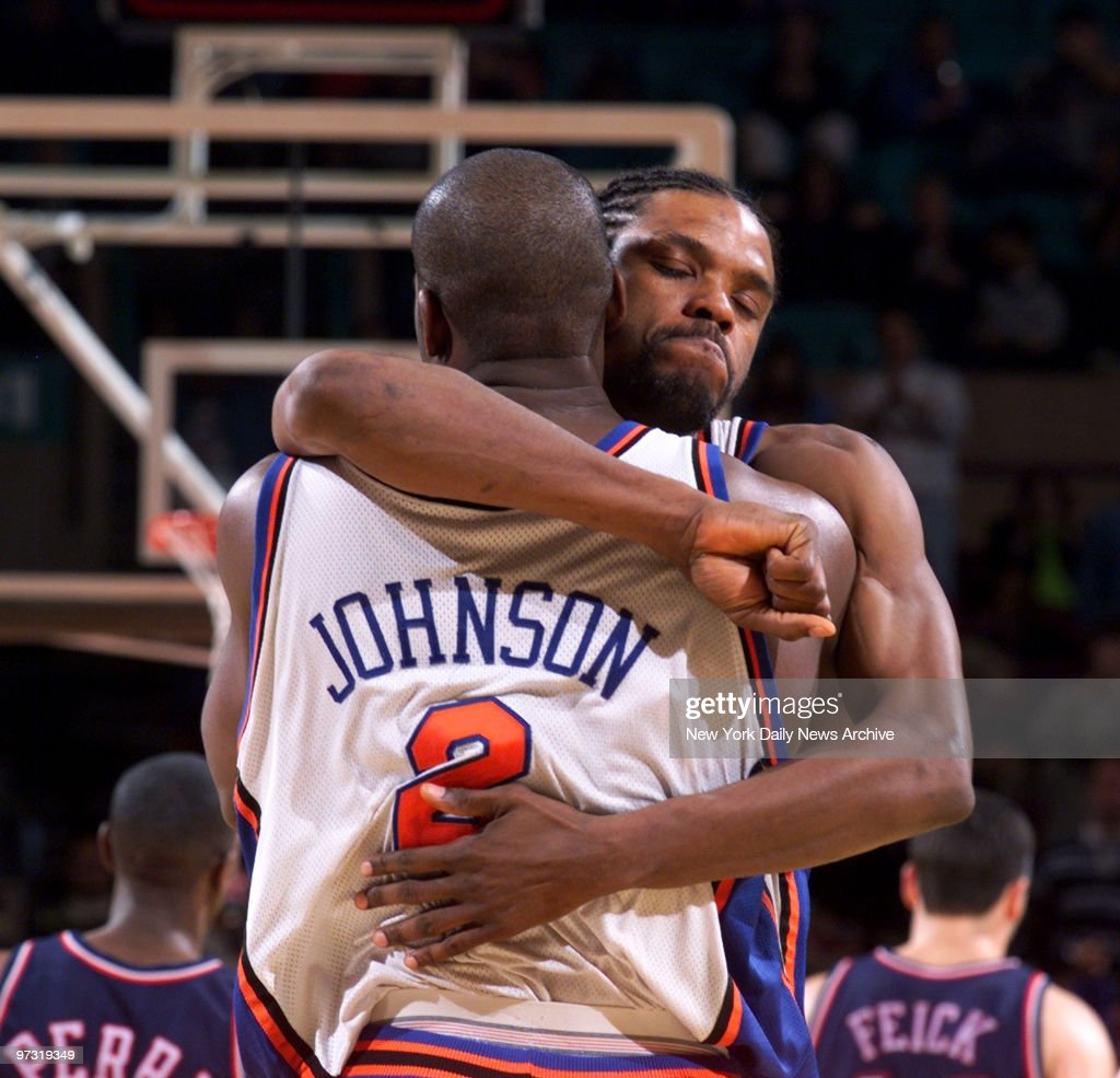 New York Knicks Latrell Sprewell hugs teammate Larry Johnso