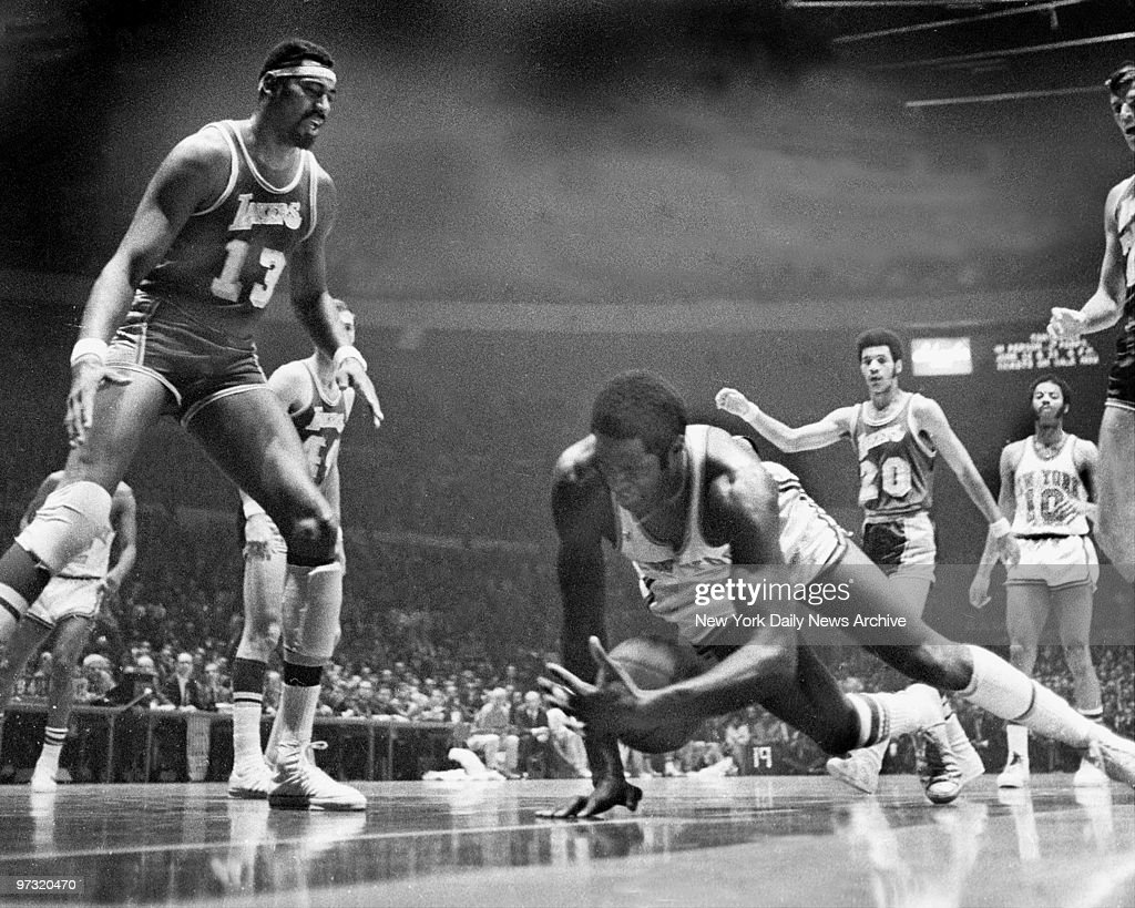 New York Knicks MVP center Willis Reed falls heavily to the