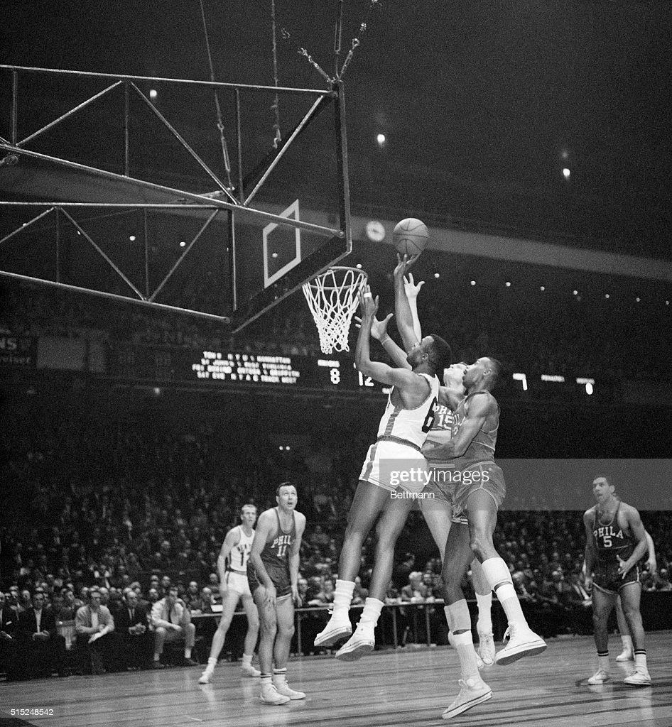 Wilt Chamberlain and Willie Naulls at Basket