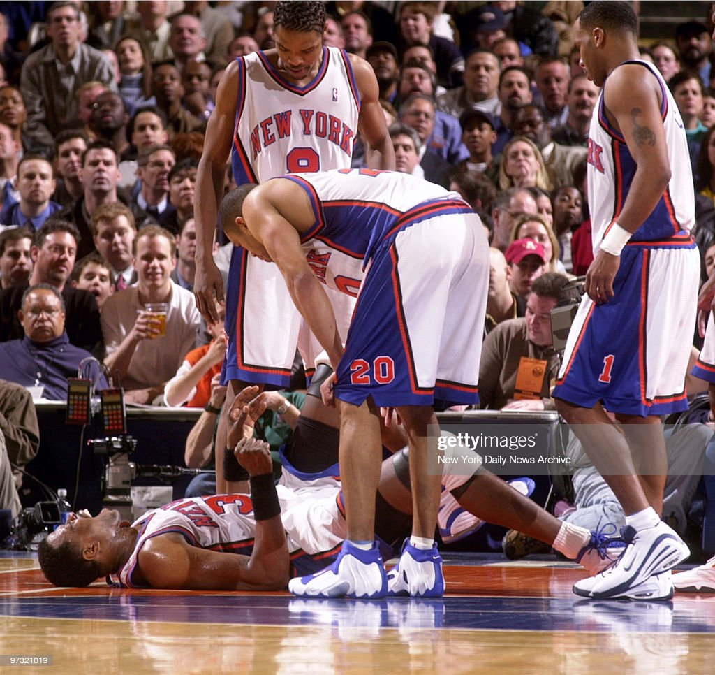 New York Knicks Patrick Ewing grimaces in pain after going