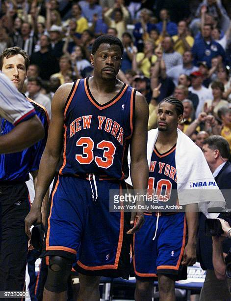 New York Knicks' Patrick Ewing leaves the court followed by Kurt Thomas at end of Game 5 of the NBA Eastern Conference finals at Conseco Fieldhouse...