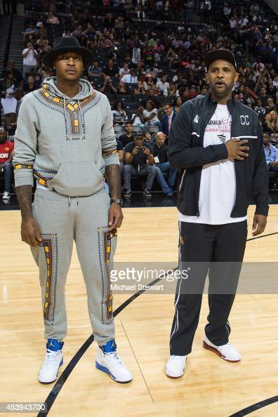 New York Knicks player Carmelo Anthony and New York Yankees player CC Sabathia attend the 2014 Summer Classic Charity Basketball Game at Barclays...