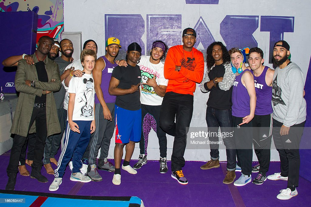 New York Knicks player Carmelo Anthony (5th from right), Rocco Ritchie (3rd from right) with Brooklyn Beast instructors attend Flipeez Presents Kasseem's Dream Halloween Party at BKLYN BEAST on October 29, 2013 in Brooklyn, New York.