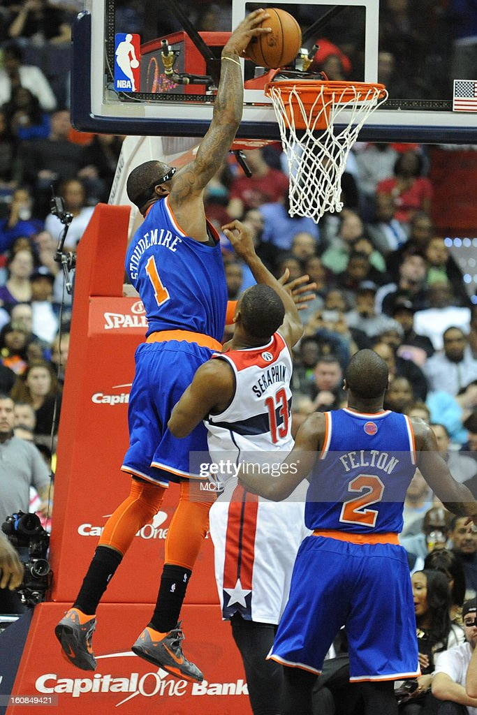 New York Knicks power forward Amar'e Stoudemire (1) drives to the basket over Washington Wizards power forward Kevin Seraphin (13) during second-half action at the Verizon Center in Washington, D.C., Wednesday, February 6, 2013. The Wizards won, 106-96.