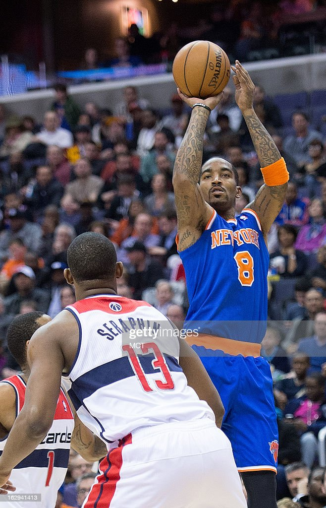 New York Knicks shooting guard J.R. Smith (8) shoots over Washington Wizards power forward Kevin Seraphin (13) during the first half of their game played at the Verizon Center in Washington, D.C., Friday, March 1, 2013.