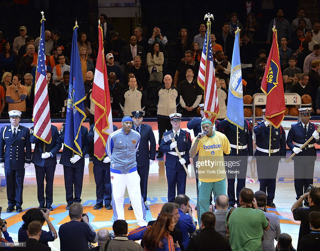 New York Knicks vs Boston Celtics, Eastern Conference. New York Knicks small forward Carmelo Anthony (7) and Boston Celtics small forward Paul Pierce (34) with Boston Police Department's color guard to send condolences to Beantown.