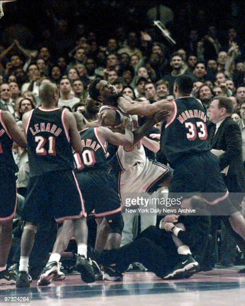 New York Knicks vs Miami Heat at MSG for Game4 Knicks Charles Oakley is shoved by Heats Alonzo Mourning while Jeff Van Gundy got a piece of Alonzo's...