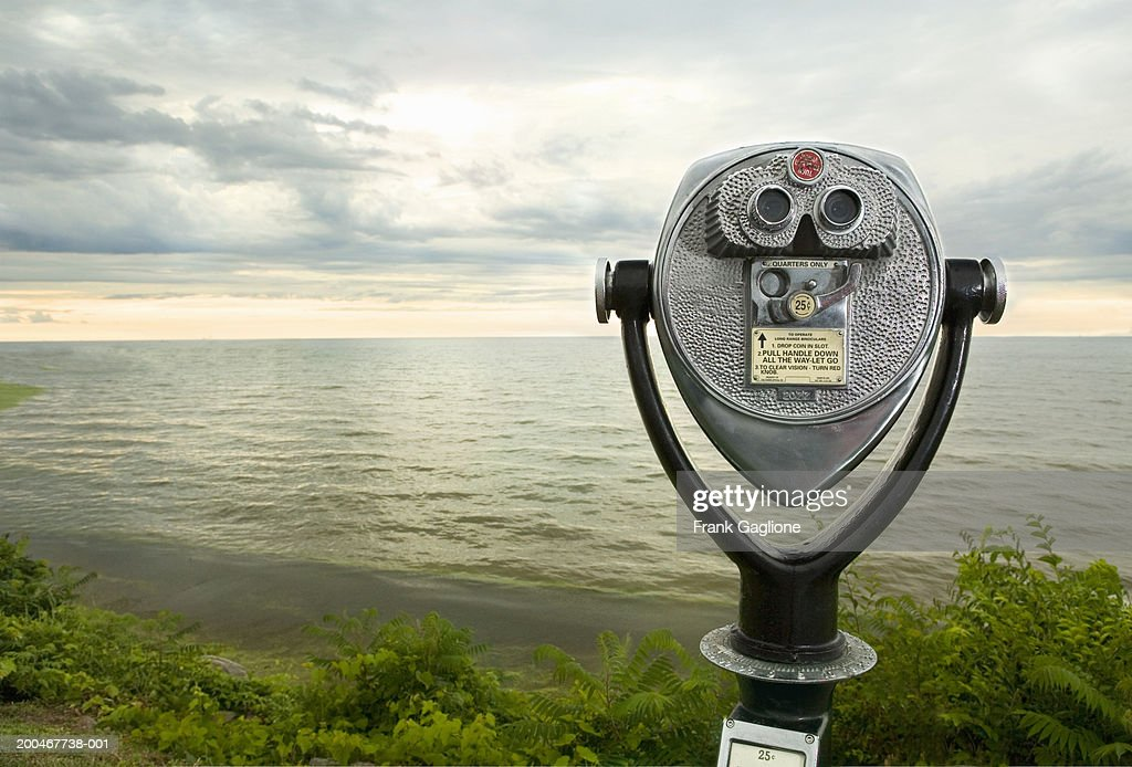 USA, New York, Lake Ontario, coin-operated binoculars at sunset