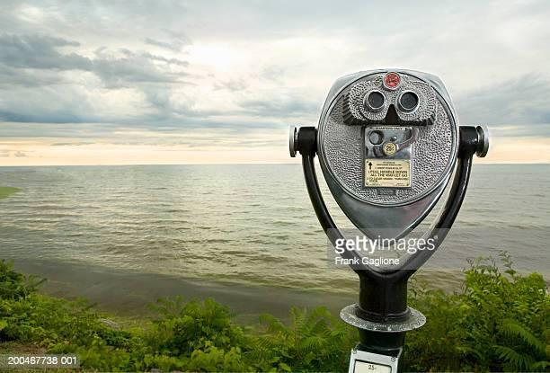 USA, New York, Lake Ontario, coin-operated binoculars at sunset