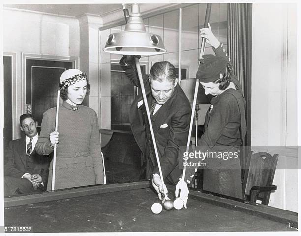 Lessons From a ChampAt Carom Club Miss Fannie Robb and Mrs Laurence Tower take masse shot lessons from Welker Cochran world's 182 Balkline champion...