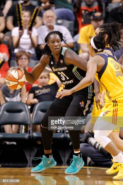 New York Liberty center Tina Charles backs down into Indiana Fever forward Candice Dupree during the game between the New York Liberty and Indiana...