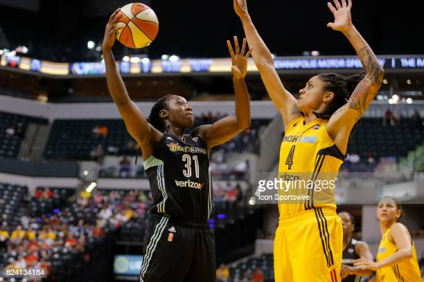 New York Liberty center Tina Charles goes up with her shot over Indiana Fever forward Candice Dupree during the game between the New York Liberty and...