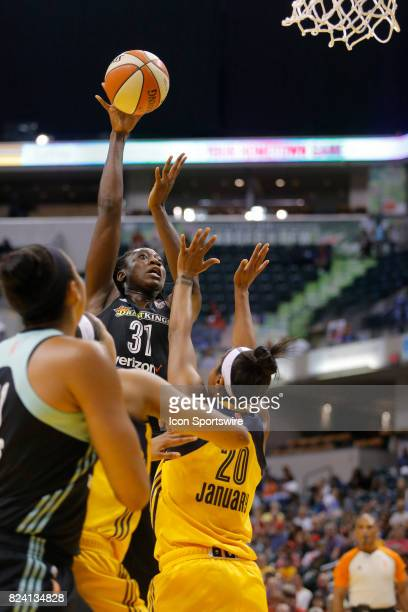 New York Liberty center Tina Charles with the shot over Indiana Fever guard Briann January during the game between the New York Liberty and Indiana...