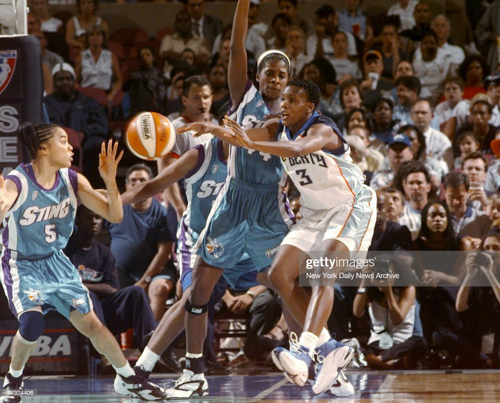 New York Liberty forward Crystal Robinson tries to pass the ball around traffic during first half of WNBA basketball action against the Charlotte...