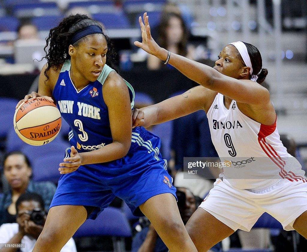 New York Liberty forward Kelsey Bone (3) dribbles against Washington Mystics center Kia Vaughn (9) in the third quarter at the Verizon Center in Washington, D.C., Wednesday, July 31, 2013, The Liberty defeated the Mystics, 88-78.