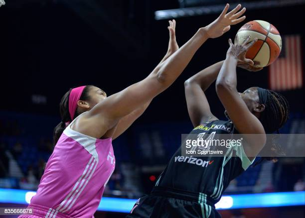 New York Liberty Guard Sugar Rodgers shoots a fade away shot over Connecticut Sun Forward Brionna Jones during the game as the Connecticut Sun host...
