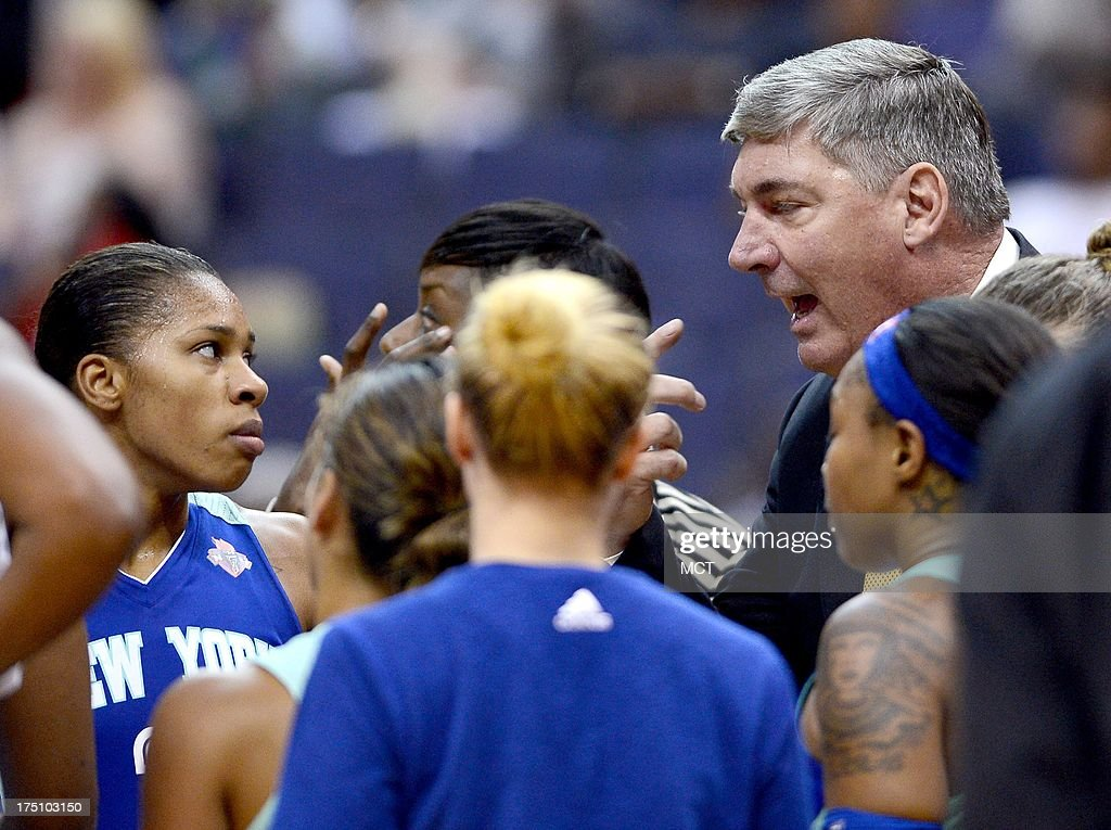 New York Liberty head coach Bill Laimbeer, right, huddles with his players during a timeout in the fourth quarter against the Washington Mystics at the Verizon Center in Washington, D.C., Wednesday, July 31, 2013, The Liberty defeated the Mystics, 88-78.