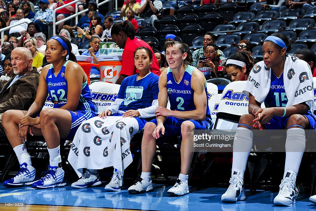 New York Liberty players, from left, Kelley Cain #52, Leilani Mitchell #5, <a gi-track='captionPersonalityLinkClicked' href=/galleries/search?phrase=Kelly+Miller&family=editorial&specificpeople=213237 ng-click='$event.stopPropagation()'>Kelly Miller</a> #2 and <a gi-track='captionPersonalityLinkClicked' href=/galleries/search?phrase=Kia+Vaughn&family=editorial&specificpeople=4220876 ng-click='$event.stopPropagation()'>Kia Vaughn</a> #15 sit on the bench while playing against the Atlanta Dream at Philips Arena on May 25, 2012 in Atlanta, Georgia.
