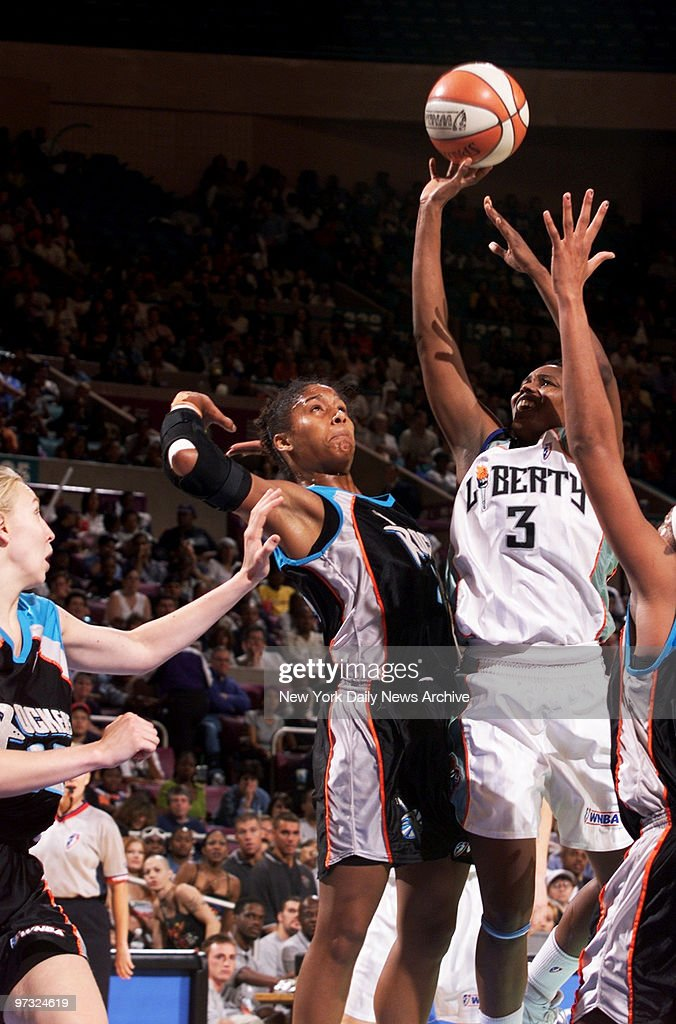 New York Liberty's Crystal Robinson shoots over Cleveland Rockers' Mery Andrade in the second of three games in the WNBA Finals at Madison Square...