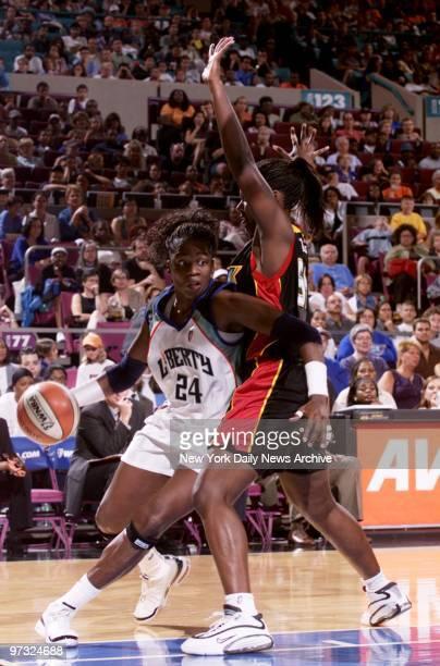 New York Liberty's Tari Phillips works her way around the Detroit Shock's Barbara Farris at Madison Square Garden The Liberty rallied to nip the...