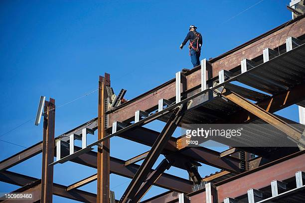 USA, New York, Long Island City, Construction worker on construction frame