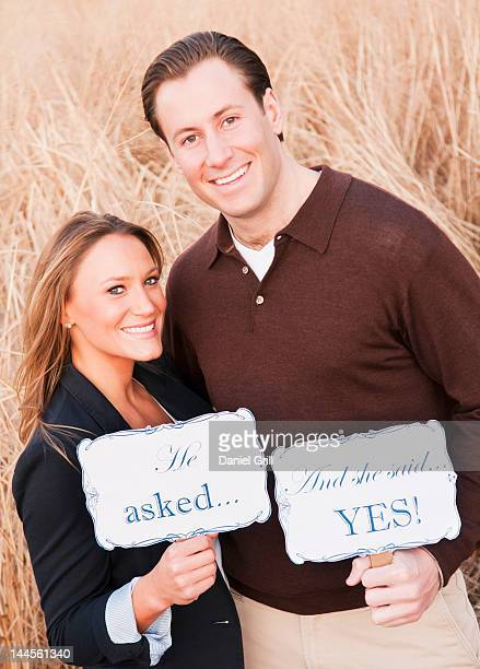 USA, New York, Long Island City, Portrait of happy young couple on wheat field