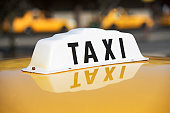 USA, New York, Long Island, New York City, Close up of taxi sign