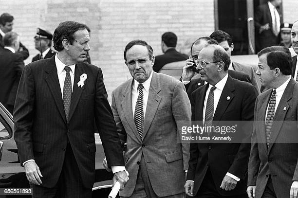 New York Major Rudy Giuliani and unidentified officials at JFK International Airport following a briefing with President Bill Clinton and a press...
