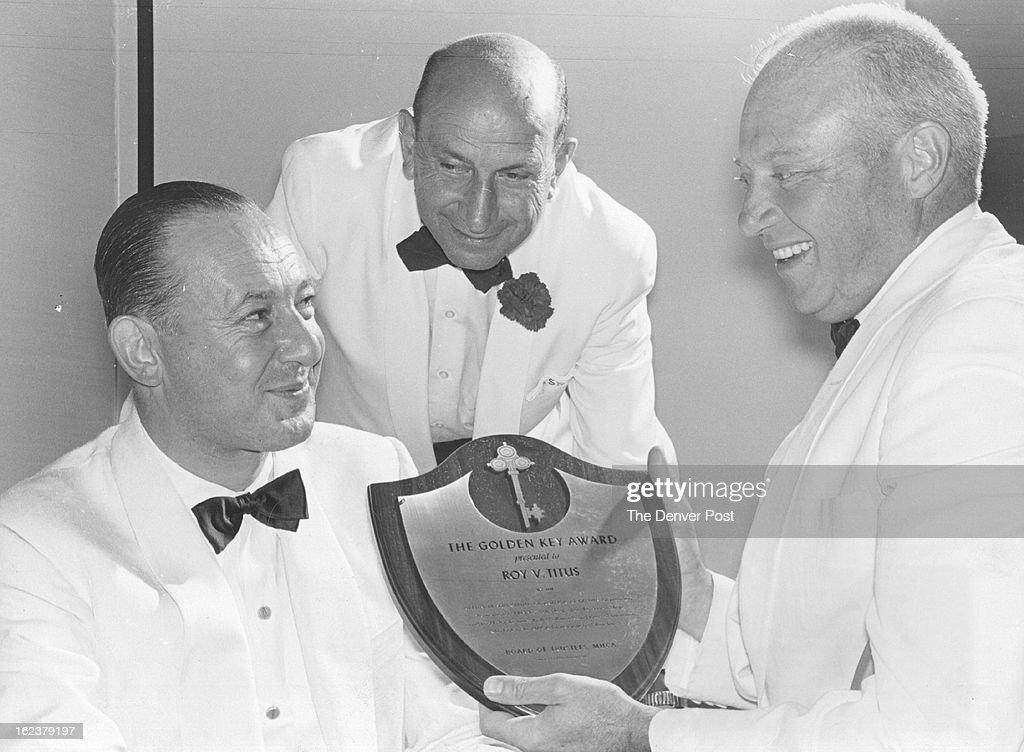 AUG 30 1960; New York Man Gets Denver Award; Gov. Steve McNichols (right) presents the Golden Key Award of the Mental Health Cen-¡ter of America, 1980 Trenton St., to Roy V. Titus (left) of New York City, board chair-¡man and executive vice president of Helena Rubinstein, Inc., for his services in advanc-¡ing the psychiatric and research cause of the Denver institution. Looking on is John Streltzer, president of the hospital. Presentation was made at the center's $100-a-couple dinner Monday night in the Hilton Hotel.;