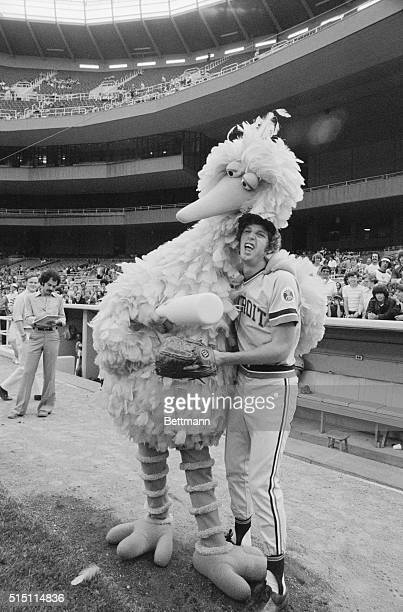 Mark Fidrych Detroit's madcap pitcher who has the lowest ERA in the majors lets out a yelp as he meets 'Big Bird' of Sesame Street fame prior to the...