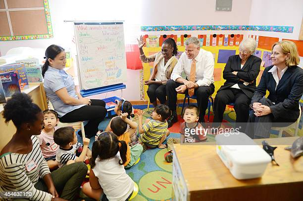 New York Mayor Bill de Blasio along with teacher Margaret Su First Lady Chirlane McCray Schools Chancellor Carmen Farina and Queens Borough President...
