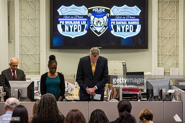 New York Mayor Bill de Blasio and his wife Chirlane McCray observe a moment of silence at 247PM the time two New York Police Department officers were...