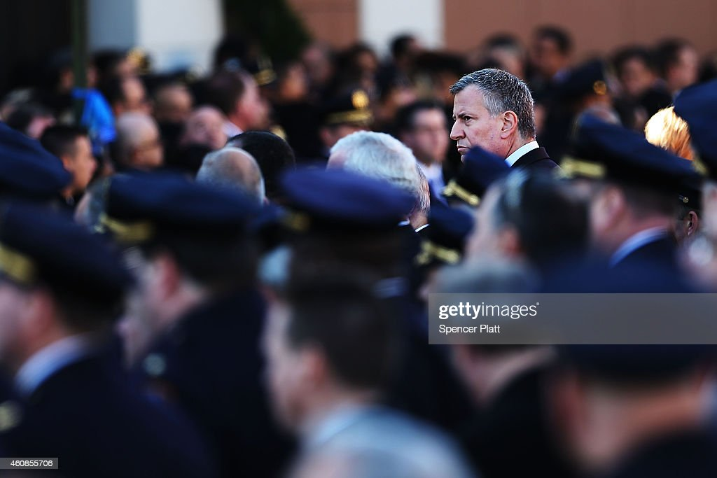 New York Mayor <a gi-track='captionPersonalityLinkClicked' href=/galleries/search?phrase=Bill+de+Blasio&family=editorial&specificpeople=6224514 ng-click='$event.stopPropagation()'>Bill de Blasio</a> attends the funeral procession outside of Christ Tabernacle Church for the slain New York City Police Officer Rafael Ramos, one of two officers murdered while sitting in their patrol car in an ambush in Brooklyn last Saturday afternoon on December 27, 2014 in New York City. Thousands of fellow officers, family, friends and Vice President Joseph Biden are expected at the church in the Glendale neighborhood of Queens for the funeral.