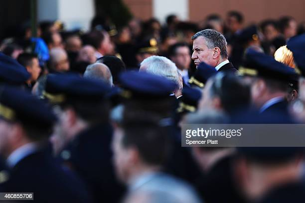 New York Mayor Bill de Blasio attends the funeral procession outside of Christ Tabernacle Church for the slain New York City Police Officer Rafael...