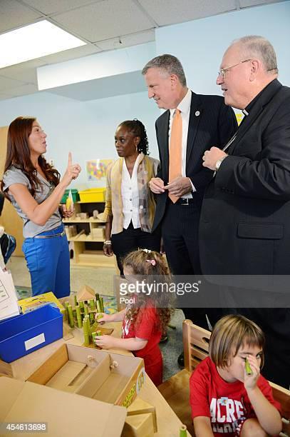 New York Mayor Bill de Blasio visits a PreK class on September 4 2014 at Sacred Heart School in the Staten Island borough of New York City New York...