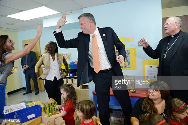 New York Mayor Bill de Blasio visits a PreK class on September 4 2014 at Sacred Heart School in the Staten Island borough of New York City New York...
