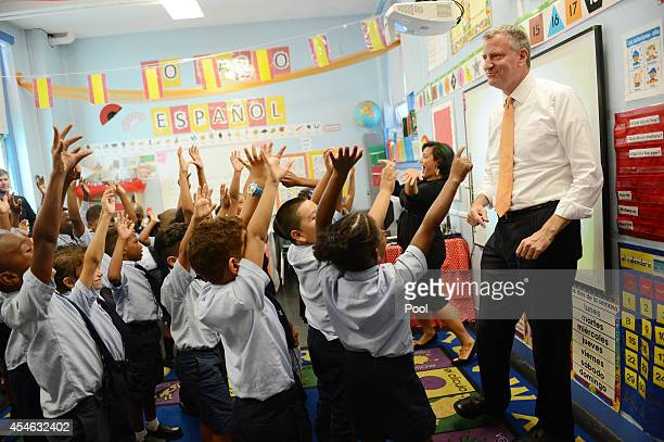 New York Mayor Bill de Blasio visits a second grade Spanish class at Amber Charter School in Manhattan on the first day of NYC public schools...