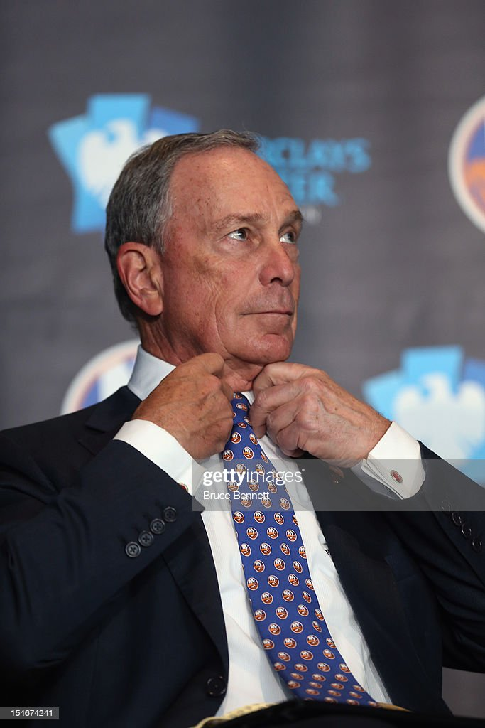 New York Mayor Michael Bloomberg adjusts his new New York Islanders tie after the announcement of the team's move in 2015 to Brooklyn at a press conference at the Barclays Center on October 24, 2012 in the Brooklyn borough of New York City.