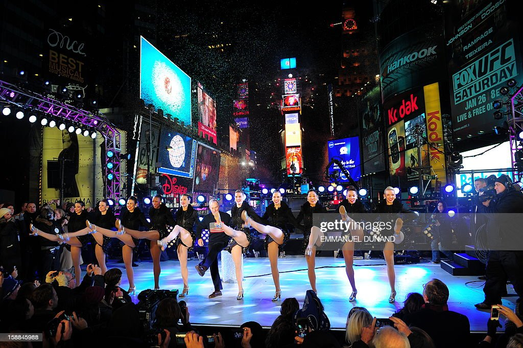 New York Mayor Michael Bloomberg and the Rockettes celebrate the New Year on Times Square in New York, January 1, 2013. A million people cheered in New York's Times Square as the traditional crystal ball dropped to mark the start of 2013, bringing a rolling global New Year's party that kicked off in Australia to US shores.