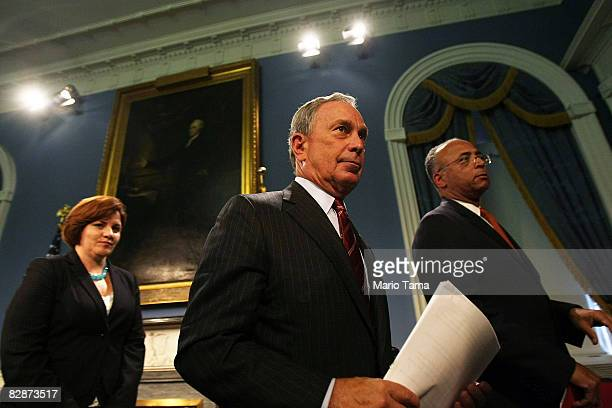 New York Mayor Michael Bloomberg departs a City Hall news conference with City Comptroller William Thompson and City Council Speaker Christine Quinn...