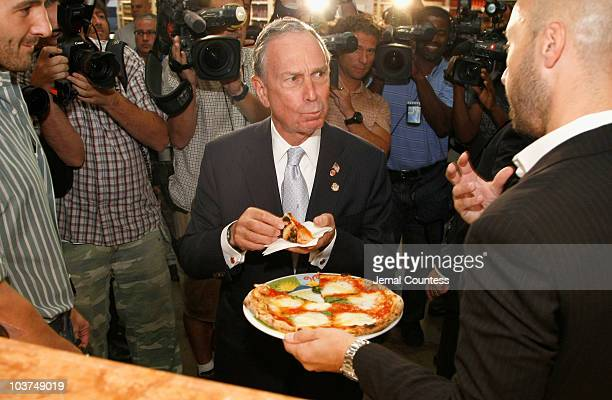 New York Mayor Michael R Bloomberg samples pizza during a tour of 'Eataly's prior to the grand opening of 'Eataly's' on August 31 2010 in New York...