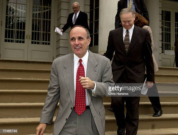 New York Mayor Rudolph Giuliani left and New York City police commissioner Howard Safir walk down the City Hall steps June 12 2000 as they head for a...