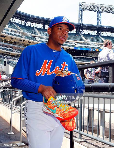 New York Mets 2013 first round draft pick 11th overall Dominic Smith looks on from the dugout before a game against the Miami Marlins at Citi Field...