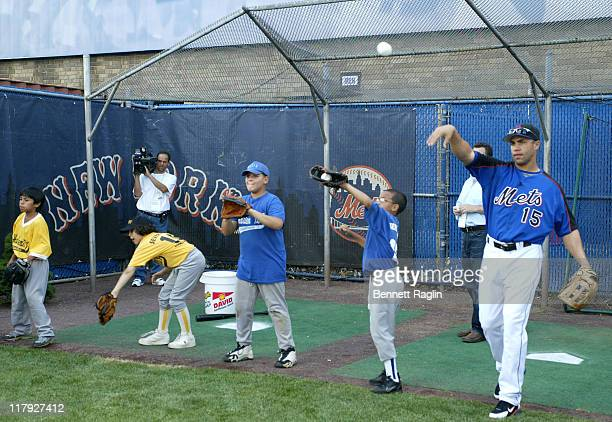 New York Mets Carlos Beltran and players at his 'Harlem RBI' clinic at Shea Stadium in Queens New York on August 8 2006 Beltran pledged $500 for...