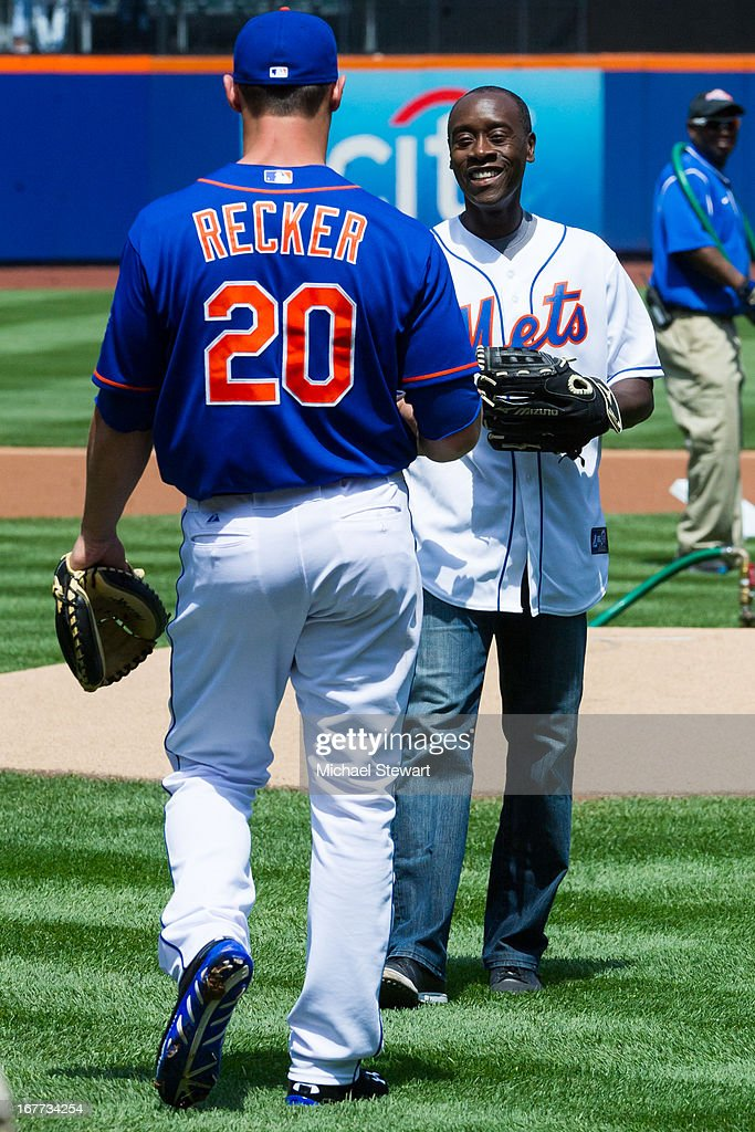 New York Mets catcher Anthony Recker (L) and actor Don Cheadle attend the Philadelphia Phillies vs New York Mets game at Citi Field on April 28, 2013 in New York City.