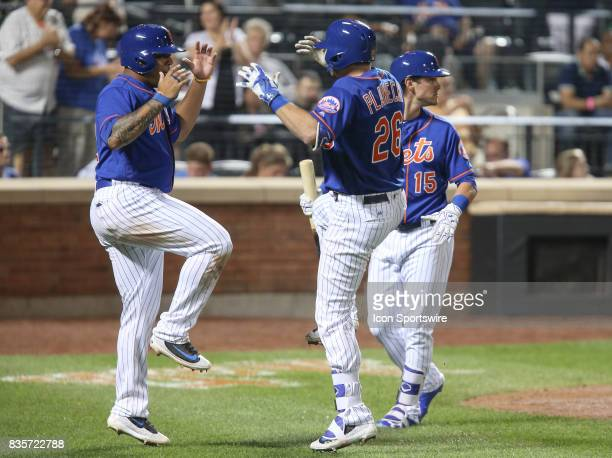 New York Mets Catcher Kevin Plawecki celebrates at home plate with teammate New York Mets First Baseman Dominic Smith following Plawecki's first home...