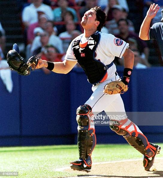New York Mets catcher Mike Piazza chases a foul ball in the top of the second inning against the Milwaukee Brewers 23 May at Shea Stadium in New York...