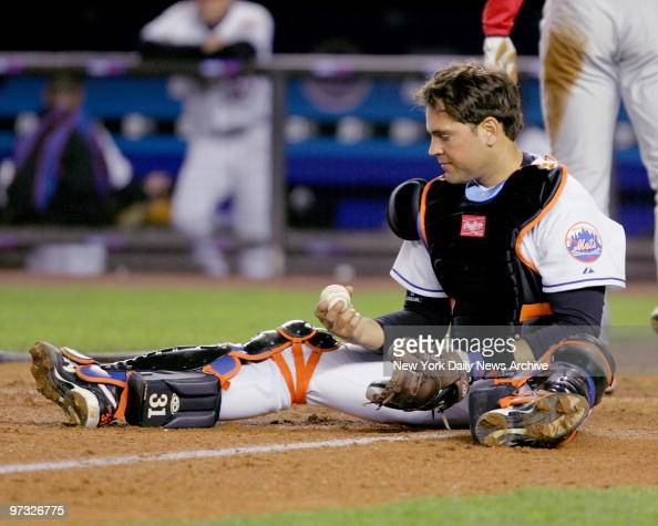 New York Mets' catcher Mike Piazza hangs on to the ball after placing the tag on Philadelphia Phillies' Pat Burrell who was out at home to end the...