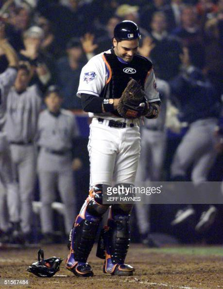 New York Mets catcher Mike Piazza reacts after two Yankees scored the winning runs past him in the top of the 9th inning of Game Five of the World...