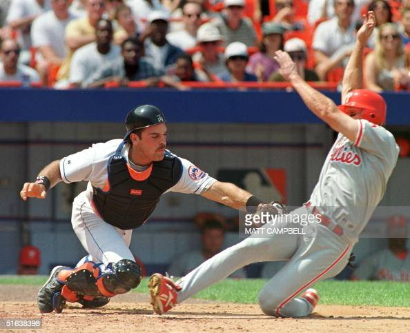 New York Mets catcher Mike Piazza tags out Philadelphia Phillies second baseman Mark Lewis after he tried to score from second base on a single in...